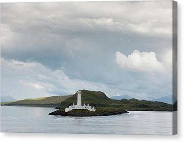 White Lighthouse Along The Coast Canvas Print by John Short