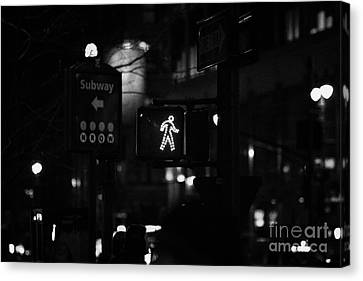 Crosswalk Canvas Print - White Man Pedestrian Walk Sign Illuminated At Night In Street Scene New York City by Joe Fox