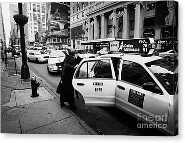 white middle aged passengers exit from yellow cab rear door at taxi rank on 7th Avenue Canvas Print by Joe Fox