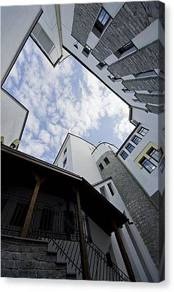 Wide View Of Building Canvas Print by Ioan Panaite