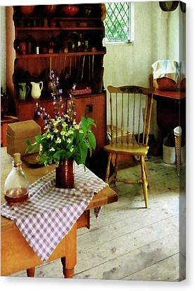 Wildflowers On Kitchen Table Canvas Print by Susan Savad