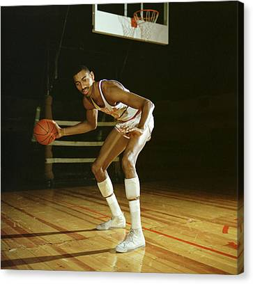 Wilt Chamberlain Dribbling Canvas Print by Retro Images Archive