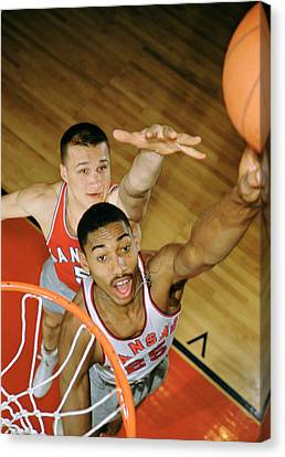 Wilt Chamberlain In College Canvas Print by Retro Images Archive