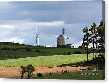 Wind Turbine And Windmill Canvas Print by Bernard Jaubert