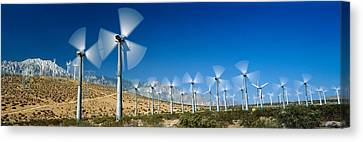Wind Turbines Canvas Print - Wind Turbines Spinning In A Field, Palm by Panoramic Images