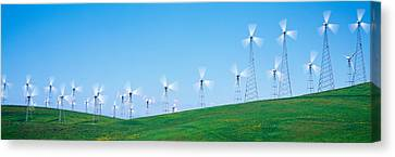 Wind Turbines Spinning On Hills Canvas Print by Panoramic Images
