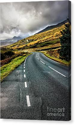 Winding Road Canvas Print by Adrian Evans