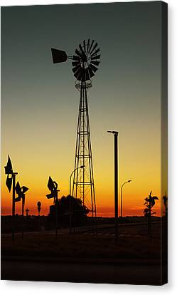 Windmill At Sunset Canvas Print by Marco Oliveira