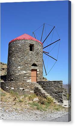 Windmill In Oia Town Canvas Print by George Atsametakis