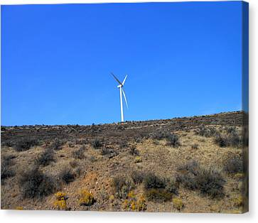 Windmill In The Desert Canvas Print by Kay Gilley