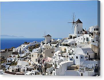 Windmills And White Houses In Oia Canvas Print