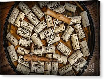 Wine Corks On A Wooden Barrel Canvas Print by Paul Ward