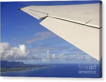 Wing Of Airplane Leaving Canvas Print by Sami Sarkis