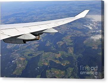 Wing Of Flying Airplane Over German Villages Canvas Print by Sami Sarkis