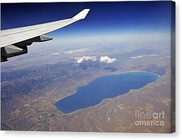 Wing Of Flying Airplane Over Lake And Mountains Canvas Print by Sami Sarkis