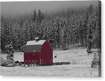 Winter Barn In Red Canvas Print by Mark Kiver