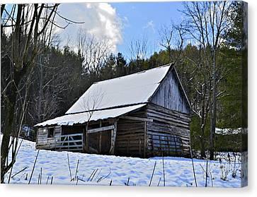 Winter Barn Canvas Print by Susan Leggett