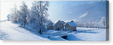 Winter Farm Austria Canvas Print by Panoramic Images