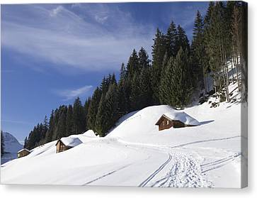 Winter Landscape With Trees And Houses In Austria Canvas Print by Matthias Hauser