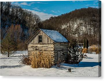 Winter Logcabin Canvas Print by Paul Freidlund