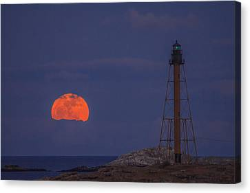 Winter Moon Rising Over Marblehead Light Canvas Print by Jeff Folger