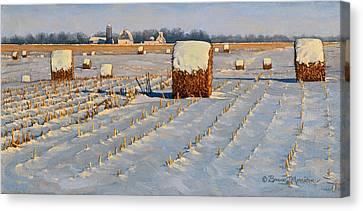 Winter Stubble Bales Canvas Print by Bruce Morrison