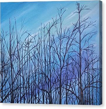 Winter Trees Against A Blue Sky Canvas Print
