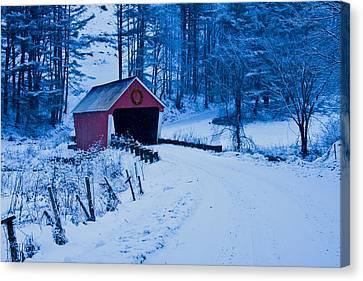 winter Vermont covered bridge Canvas Print by Jeff Folger