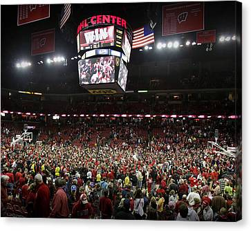 Wisconsin Fans Rush The Court At The Kohl Center Canvas Print by Replay Photos