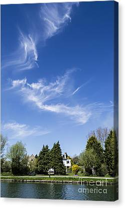 Wispy Clouds Above The River Cam Canvas Print by Keith Douglas