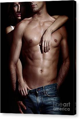 Woman Behind Sexy Man With Bare Torso And Jeans Canvas Print
