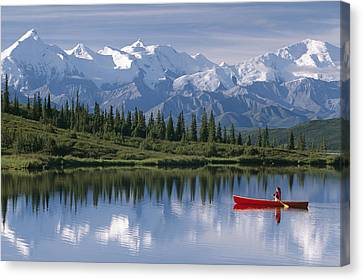 Woman Canoeing In Wonder Lake Alaska Canvas Print by Michael DeYoung