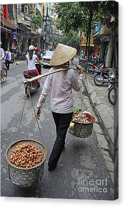 Woman Carrying Baskets Of Fruits Canvas Print