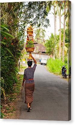 Woman Carrying Offering To Temple Canvas Print by Panoramic Images