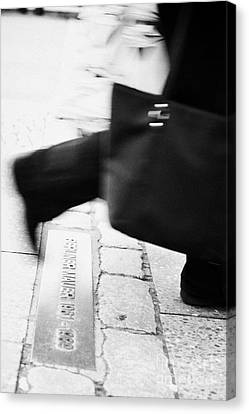 woman carrying shopping bag walking over double row of bricks across berlin to mark the position of the berlin wall berliner mauer Berlin Germany Canvas Print