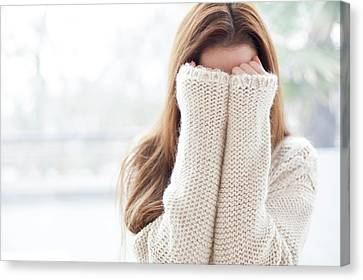 Covering Up Canvas Print - Woman Covering Face by Ian Hooton