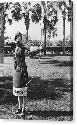 Woman Demonstrates A Longbow Canvas Print by Underwood Archives