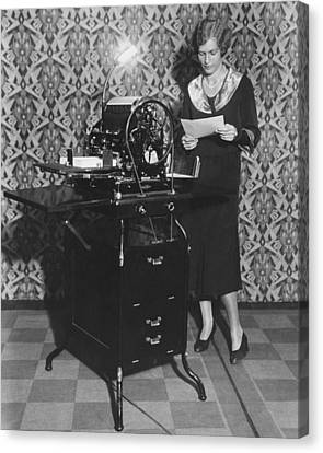 Woman Demonstrates Duplicator Canvas Print by Underwood Archives