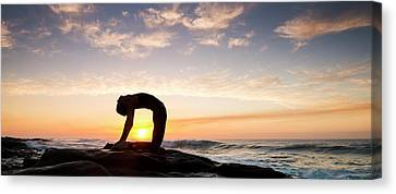 Woman Doing Yoga Camel Pose Canvas Print by Panoramic Images