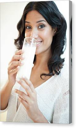 Woman Drinking Milk Canvas Print by Ian Hooton