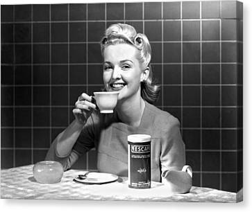 Woman Drinking Nescafe Canvas Print by Underwood Archives