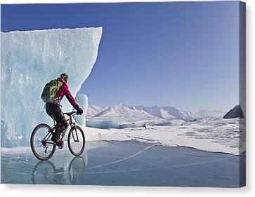 Woman Fat Tire Mountain Biking On Ice Canvas Print by Joe Stock