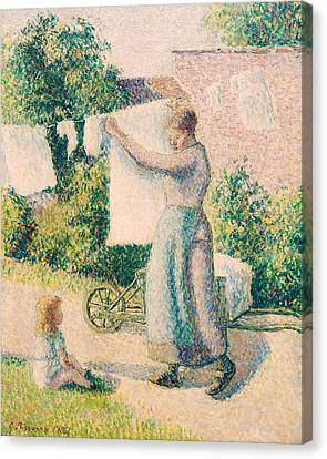 Woman Hanging Laundry Canvas Print by Camille Pissarro