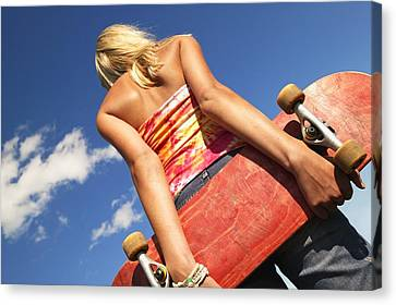 Woman Holding A Skateboard Canvas Print by Don Hammond