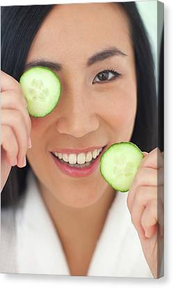 Chinese Ethnicity Canvas Print - Woman Holding Cucumber Slices by Ian Hooton