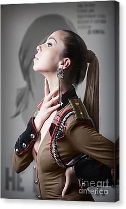 Woman In Russian Fetish Uniform Caressing Her Throat With Her Hand Canvas Print by Joe Fox