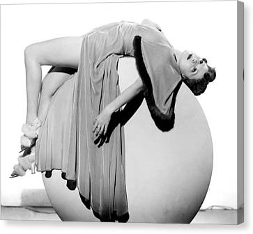 Woman Lying On Exercise Ball Canvas Print by Underwood Archives