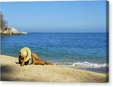 Woman Lying On The Beach Canvas Print by Aged Pixel