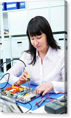 Woman Making A Micro Processor Canvas Print by Wladimir Bulgar