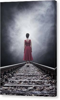 Woman On Tracks Canvas Print by Joana Kruse